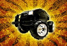 Toy Monster Truck. Black remote control monster truck isolated on yellow grunge spiral background stock photo