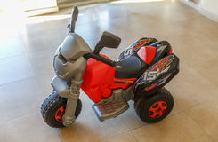Toy motorcycle in the living room of a house Stock Photography