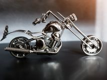 Toy motorcycle made of metal on a dark background stock image