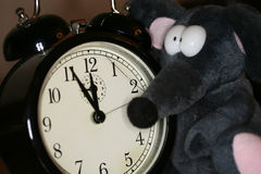 Toy mouse and clock Stock Photography