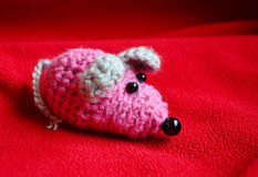 Toy mouse knitted by a child Stock Photo