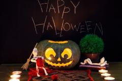 Toy mummies and jack-o'-lantern. Royalty Free Stock Photo