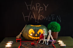 Toy mummies and jack-o'-lantern. Stock Images
