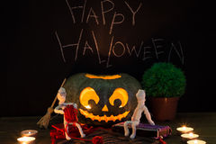 Toy mummies and jack-o'-lantern. Royalty Free Stock Images