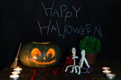 Toy mummies and jack-o'-lantern. Royalty Free Stock Photos