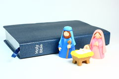 Toy Nativity and Bible. A children's nativity set in front of The Bible on a light background Stock Photos