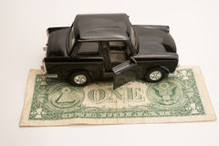 Toy old car for one dollar Stock Photo