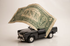Toy old car for one dollar Stock Image