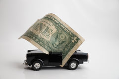 Toy old car for one dollar Stock Images
