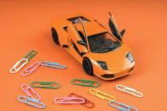 Toy orange car, on orange background. Sports car, close-up shot royalty free stock photography