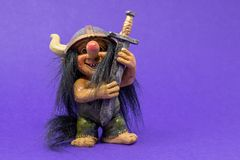 A toy, ornamental troll with a huge nose and big eyes wearing a royalty free stock photography