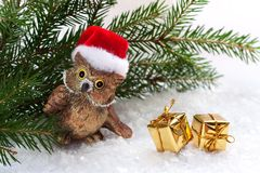 Toy owl and Christmas gifts Stock Photography