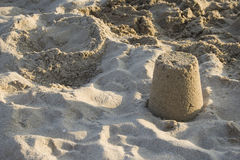 Toy pail of sand. Steal of sand from toy pail stock image