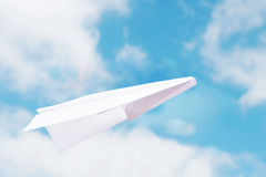 Toy paper plane flies in the sky Royalty Free Stock Image