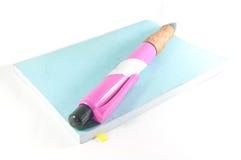 Toy pen on  book Stock Photos