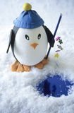 Toy penguin fishing Royalty Free Stock Photo