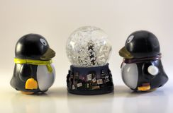 Toy Penguins Looking At Snow-Bol royalty-vrije stock foto's