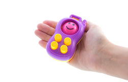 Toy phone in hand Stock Photography
