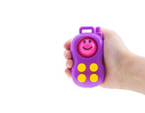 Toy phone in hand Royalty Free Stock Images