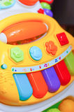 Toy piano. Colorful keys of a plastic toy piano Stock Photos