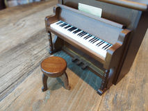 Toy piano. Wooden toy piano on vintage table background royalty free stock photo