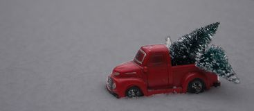 Toy pickup truck loading Christmas trees in the snow Stock Photography