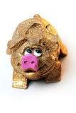 Toy pig. Cheerful souvenir gift - gold toy pig Royalty Free Stock Images