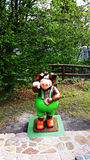 Toy pig in park whit tree. Royalty Free Stock Photo