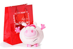 Toy piglet as christmas gift isolated on white Stock Photography