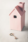 Toy pink house with gold key Royalty Free Stock Images