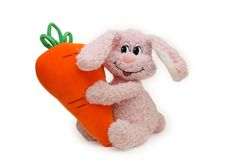 Toy pink rabbit with carrot Royalty Free Stock Photo