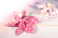 Toy pink windmill with white dots. Toy pink windmill white dots summer Beach fun kids soft royalty free stock photo