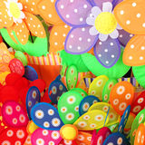 Toy pinwheels which are bright and colorful. Vibrant color background of pinwheels for summer time backyard decoration Stock Photography
