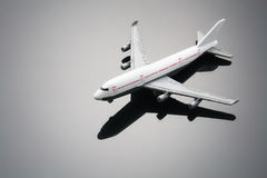 Toy Plane. With Reflection on Grey Background Stock Photo