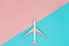 Toy plane on blue and pink pastel. Copy space royalty free stock photos