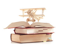 Toy plane on the book Stock Photo