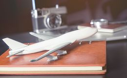 Toy plane on business office desk for business travel Royalty Free Stock Images