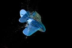 Toy plane crashing through water Royalty Free Stock Photography