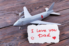 Toy plane and Dad`s card. Royalty Free Stock Image