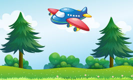 A toy plane flying above the hill Stock Photos