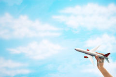 Toy Plane flying against clouds Stock Image