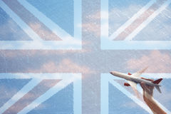 Toy plane flying in front of Union Jack flag.  stock images