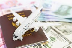 Toy Plane is on a passport, China Yuan, and dollar banknote. royalty free stock photo