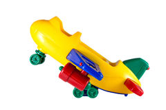 Toy plane. The toy plane from plastic on a white background royalty free stock photo