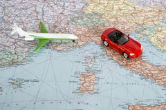 Toy plane and red car on the geographical map of Europe. Travel route planning concept.  stock photo