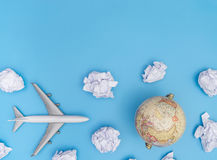 Toy plane is traveling the world globe concept Stock Image