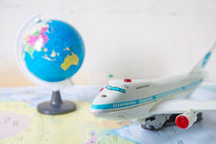 Toy plane on world map. Toy plane resting on world map royalty free stock images