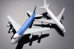 Toy Planes. With Reflection on Grey Background royalty free stock photos