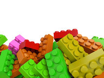 Toy plastic bricks background in warm colors Royalty Free Stock Photos