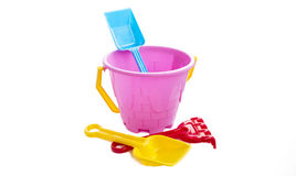 Toy plastic bucket with a shovel and a rake Royalty Free Stock Photo